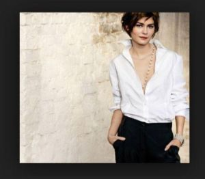 Parisian actor Audrey Tautou wearing classic crisp white blouse